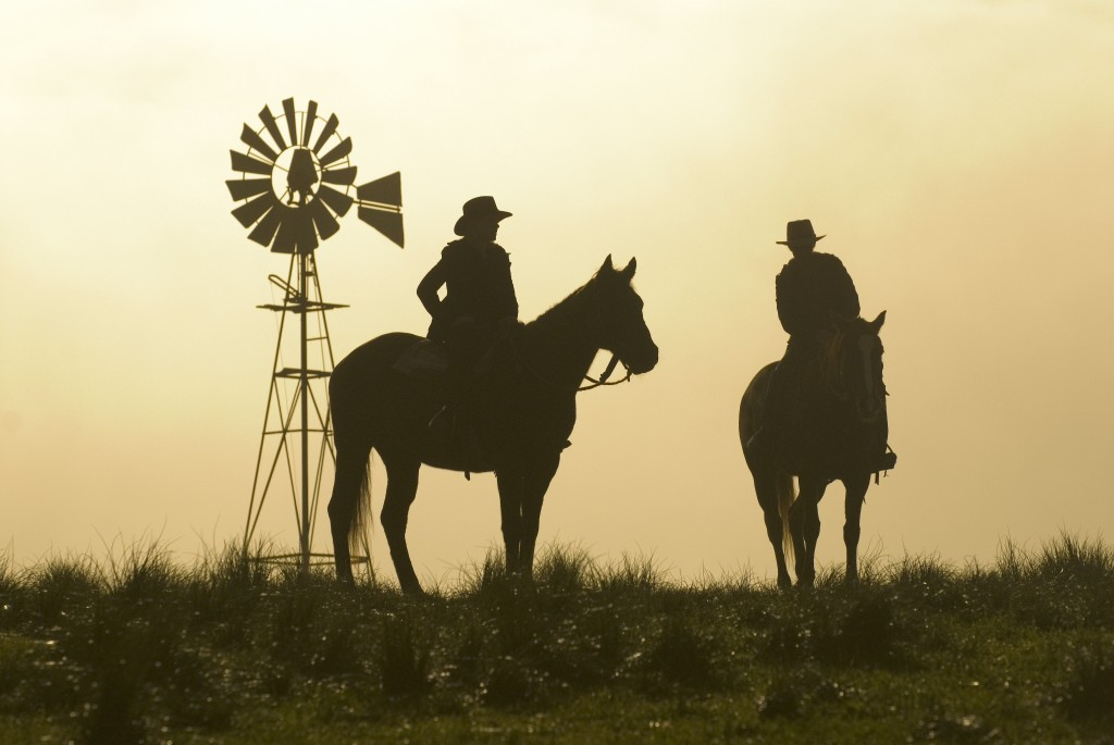 McLeods Daughters windmill - sunset and two girls on horseback